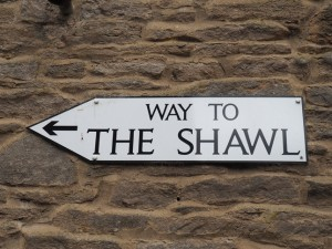 A sign pointing the way to The Shawl