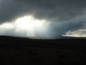A shaft of light pierces the cloud
