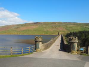 Looking across Scar House Dam towards Dead Man's Hill