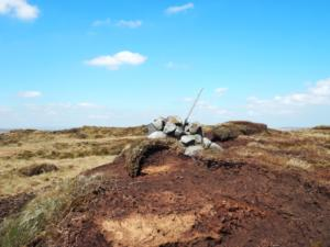 The cairn at on the peaty top of Little Whernside