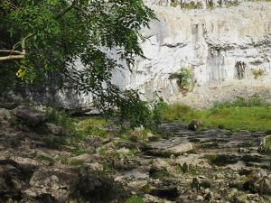 Malham Beck emerging from the foot of Malham Cove