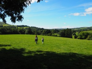 Lisa and Rhiannon crossing one of the pastures above Coverham Abbey