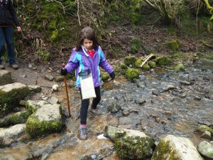 Rhiannon crossing a side stream in Whitfield Gill