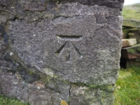 An Ordnance Survey cut benchmark on the corner of the shooting house
