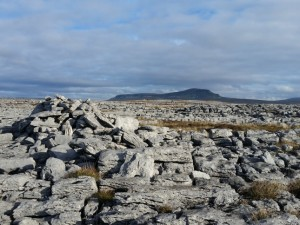Looking across some limestone pavement towards Pen-y-ghent