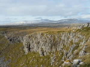A snow topped Ingleborough beyond Moughton Scars