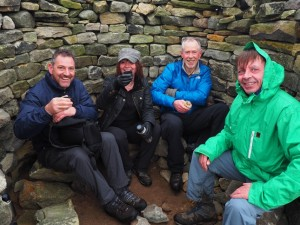 Having lunch in the shelter of the cairn