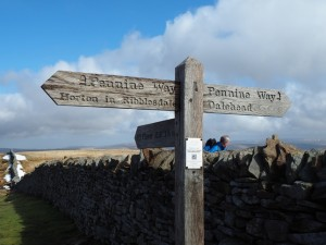 The Pennine Way sign on the top of Penyghent