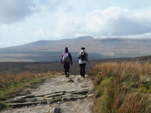 Cath, Kelly on the Pennine Way with Ingleborough in the distance