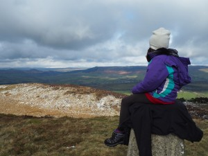 My daughter taking in the view from the trig point
