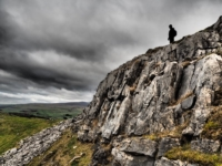 Tony above the rim of the limestone crag to the west of Smearsett Scar