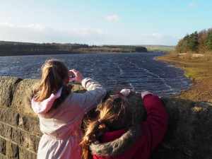 Shannon and Evie looking across Fewston Reservoir
