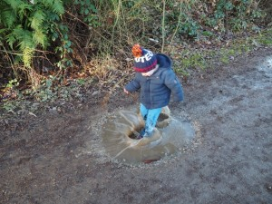 My nephew Daniel ploughing through the puddles