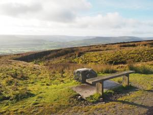 The bench and view indicator from the parking area on Askrigg Common