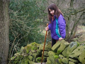 My daughter crossing a stile above Darley Beck