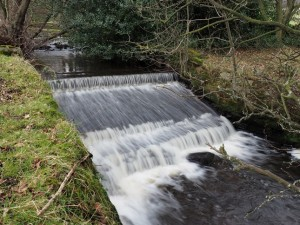 A weir on Padside Beck just upstream from Thornthwaite Mill