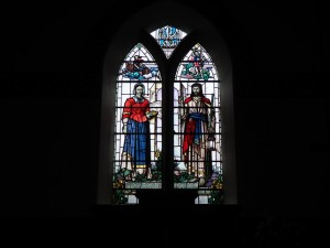 The stained glass window in the church