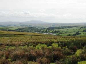 Winterburn Reservoir and a distant Pendle Hill