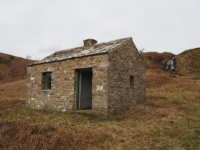 The hut above the northern edge of the tarn