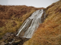 The waterfall behind the hut