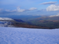 A view of Dentdale with the snow capped Lakeland fells in the far distance