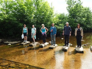 Group shot on some stepping stones over the River Dee