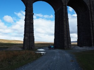 The team passing back under Ribblehead viaduct