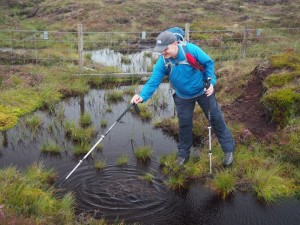 Paul depth testing a bog on Pickerstone Ridge