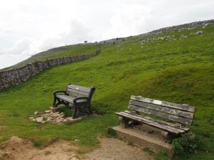 The two benches with the wall I followed beyond