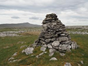 A large cairn on White Scars looking towards Whernside