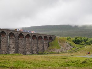 A train passes over Ribblehead Viaduct