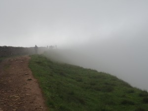The cloud closes in as the team approach the top of Whernside