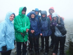 A tired and very wet team on the summit of Ingleborough